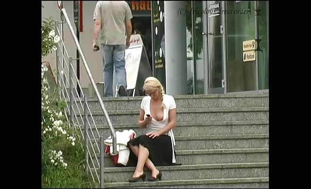 Public slut flashes on stairs