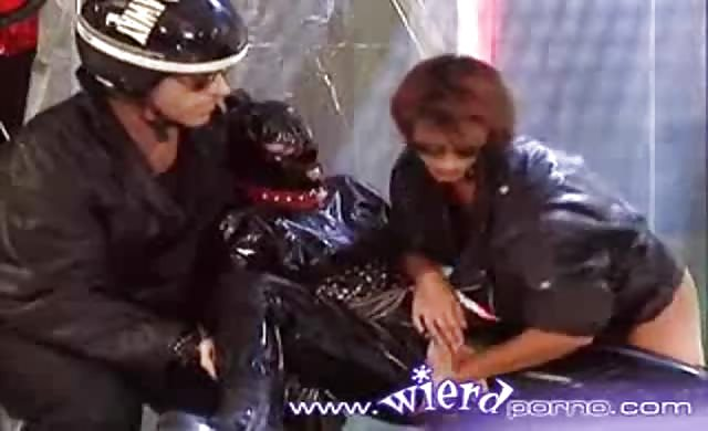 Latex covered lesbian gets fisted by her girl